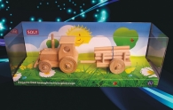 Tractor wooden toy with trailer of timber
