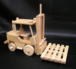 Forklift with wooden pallet. Moving wooden toys