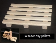 Wooden pallets for a toy forklift truck
