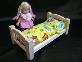 Holzpuppenbett inkl. Bettwäsche