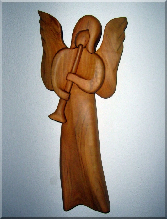 Angel with trumpet, wood sculpture
